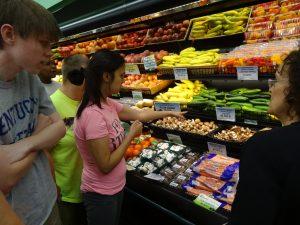 Girl Examining Produce