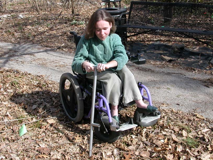 Woman in wheelchair using device to test the soil