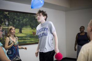 Boy Playing Balloon Lava Game