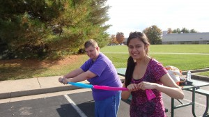 Monica and Brandy demonstrating resistance band exercises.