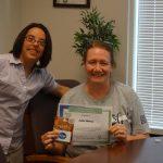 megan mccormick with student and award