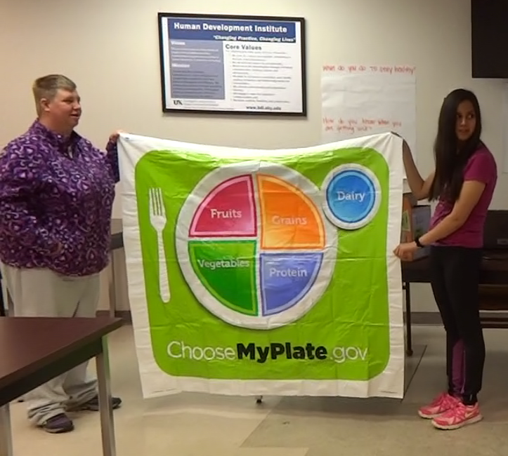 holding up choosemyplate.gov banner
