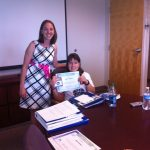 megan and student with award
