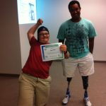 morgan awarding a certificate to young student