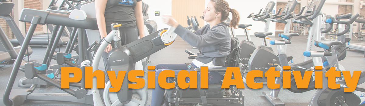 Photo of a girl who uses a wheelchair participating in physical activity at a gym.